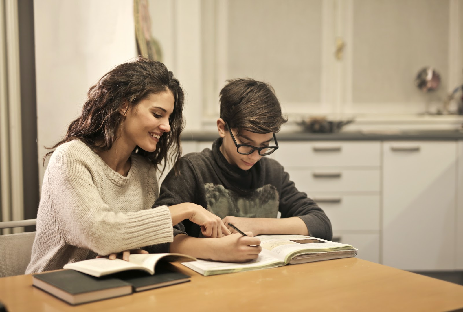 elder-sister-and-brother-studying-at-home-3769981-1